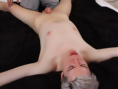 Tied down to the bed naked, Calvin Croft cuts quite a fine figure with his smooth skin and silvery hair. Leo James thinks so too, giving him a full body massage, sucking his beautiful cock and jerking both their dicks at the same time.