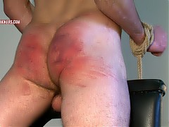 Gagged, tied to a spanking bench, underwear cut off him, arse caned till his arse burns red, made to cry out and fight against his restraints, genitals fondled, fucked.
